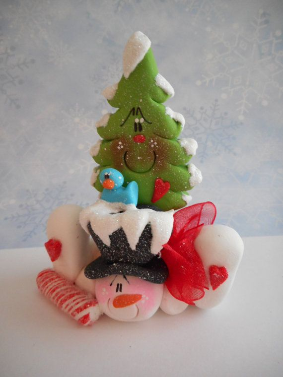 This sprawled out snowman with a Christmas Tree on his back is handmade using Premo polymer clay. He is approximately 3.75 tall by approximately 3