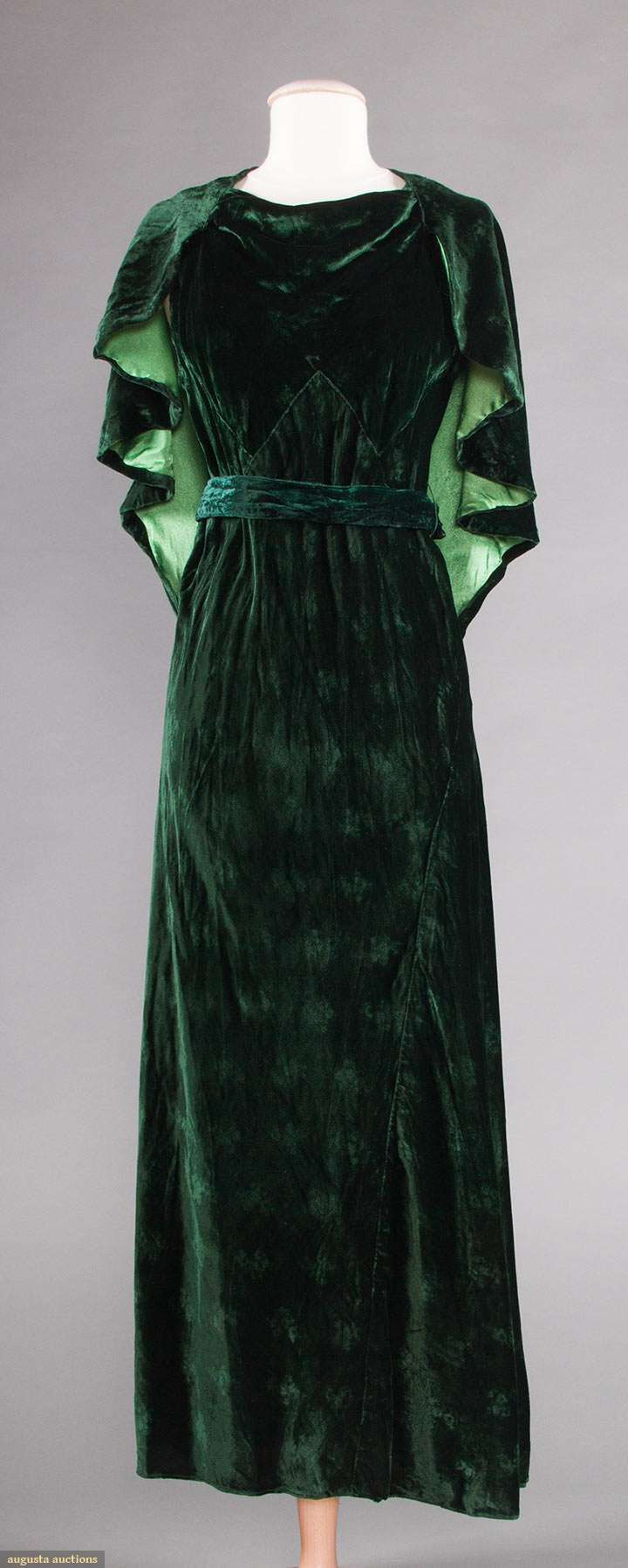 1930's forest green w/ embossed small floral pattern, sleeveless w/ attached shoulder capelet & belt