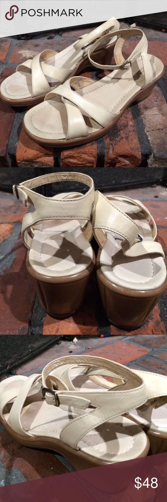 Dansko wedge Strappy heels size 40 Dansko wedge Strappy heels size 40.  Cream color leather  uppers.  Super comfortable.  2 inch heel. Dansko Shoes Sandals