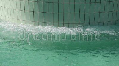 Jacuzzzi with thermal water - bubble jet relaxing against wall.