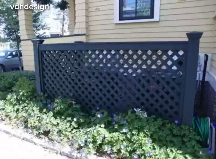 5 Ways to Hide That Big Air Conditioner in Your Yard