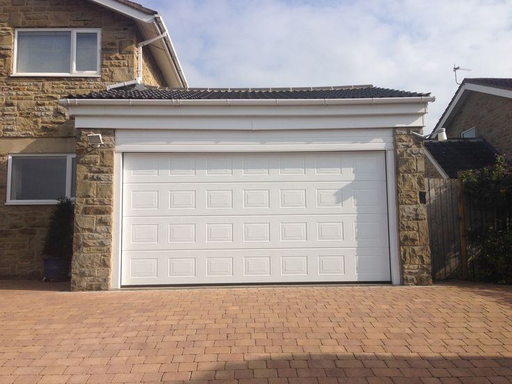 case study fully automatic hrmann made to measure insulated georgian design sectional door including a low headroom kit installed in pannal harrogate