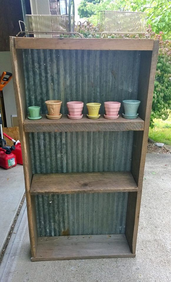 Barnwood bookshelf with galvanized metal backing