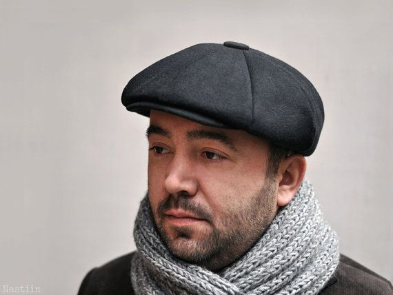 Male wearing black cabbie hat and grey scarf