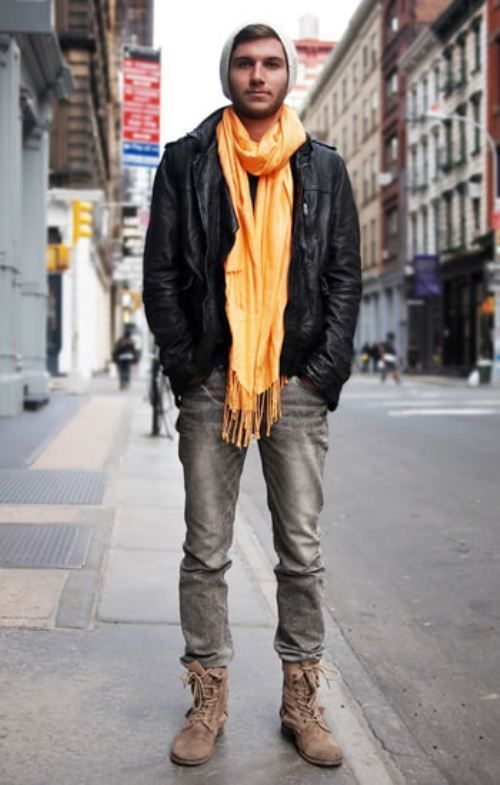 Go for a black leather biker jacket and grey jeans to get a laid-back yet stylish look. Opt for a pair of brown suede boots to show your sartorial savvy.  Shop this look for $185:  http://lookastic.com/men/looks/beanie-scarf-biker-jacket-jeans-boots/4682  — Grey Beanie  — Orange Scarf  — Black Leather Biker Jacket  — Grey Jeans  — Brown Suede Boots