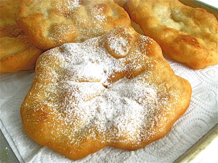Country Fair Fried Dough  2 cups Flour  2 t baking powder  3/4 t salt  Work in 2 T cold unsalted butter, in 1/2″ cubes, using a pastry blender, your fingers, or a mixer.  Stir in 3/4 cup lukewarm water, and mix to make a soft dough. Let sit 15 min.  Divide into 8 balls and flatten fry in peanut oil till brown flipping once. Serve with honey, powdered sugar or fruit topping.