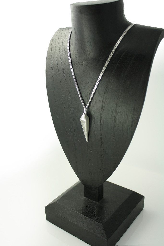 """Gladius  Beautiful and dangerous men's spiked pendant.     This heavy solid sterling silver spike pendant is carved and cast with a handmade bale dangling from a 30"""" long 3mm rhodium plated italian sterling silver men's curb chain.     The spike is just over 2 inches in length including bale and is almost half inch in width."""