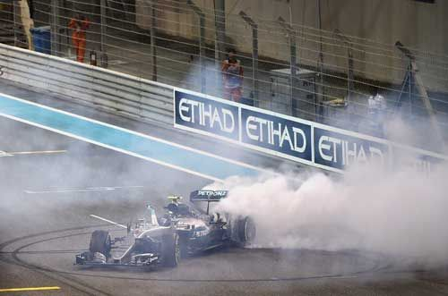 Nico Rosberg / Mercedes GP does donuts on track after finishing second and securing the F1 World Drivers Championship during the Abu Dhabi F1 Grand Prix