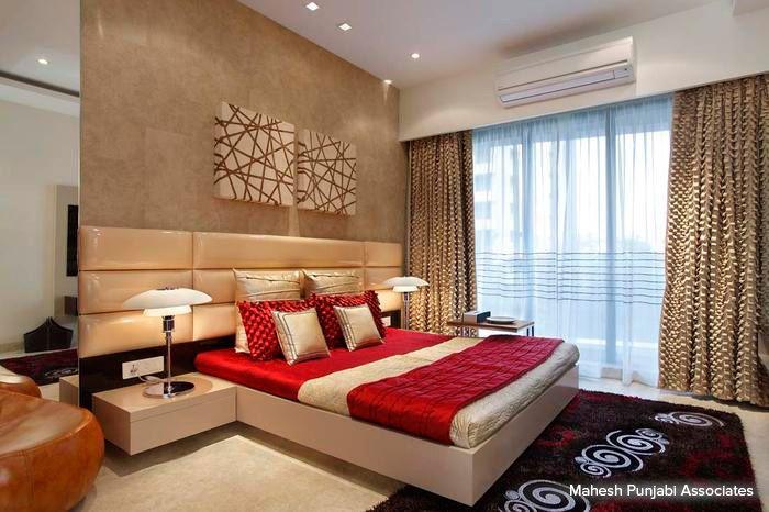 Stunning golden designer curtains and rich brown tones make this contemporary bedroom looks regal! #bedroom #homedecor #pastel #contemporary Design Courtesy - Mahesh Punjabi Associates, Mumbai