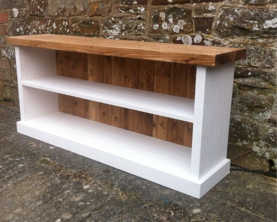 Handmade to order this storage bench is practical and sturdy. Made from solid pine, the sides and top of the shoe bench are over 3cm thick making it very sturdy. The bench pictured is 120cm in length however there different options available for length. It stands at 55cm tall so is an ideal height for sitting on. The depth is 27cm. The sides, shelves and base have been finished in pure white with an eggshell finish and the top and rear panels have been finished in a dark oak wax. If you…