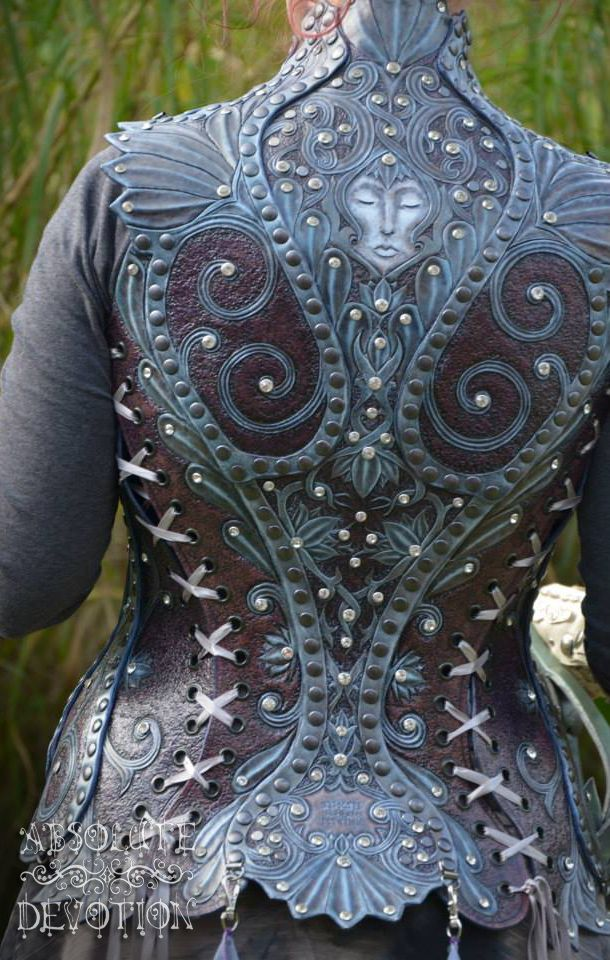 Back: Fully hand carved leather corset armor by Absolute Devotion https://www.facebook.com/pages/Absolute-Devotion/10099221406