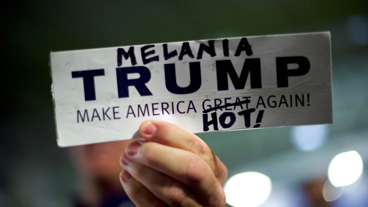 A Donald Trump supporter holds a modified campaign bumper sticker in favor of Melania Trump, wife to the Republican Presidential nominee Donald Trump, who spoke during an event at Main Line Sports in Berwyn, Pennsylvania (November 3, 2016).