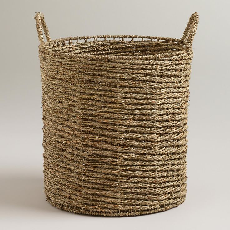 Our unique Trista Seagrass Tote Basket from Vietnam is Handcrafted with natural seagrass that's then twisted and woven around a metal frame. Its sturdy, rustic look makes it perfect for your wine cork collection, as beach towel storage or as an oversized wastepaper basket for the home office - plus, its comfy handles make it easy to transport.