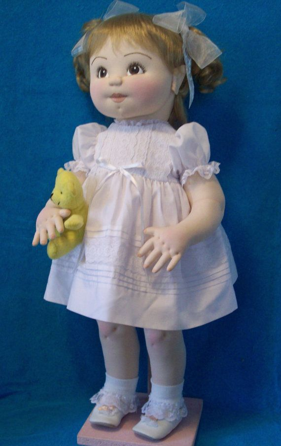 "Soft sculpture doll by MothersArmsDolls on Etsy Doll is made of nylon soft sculpture fabric. She is 25 inches tall. Her features are acrylic painted. Her dress and slip are made of white batiste. I designed and made her off of my ""Maryann"" pattern and doll and clothing is done by me. She has purchased wig, shoes and stockings. She is not for children under 5 yrs. I consider her a collectors item. The little bear is not included."