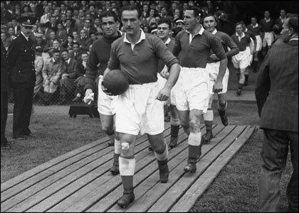 Captain George Hardwick leads the team out