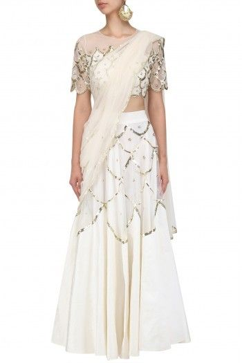 a6e98f9d6e7304 Ank By Amrit Kaur This set features an off white blouse in mesh base with  silver sequins and cutdana scallop embroidery on the front and back.