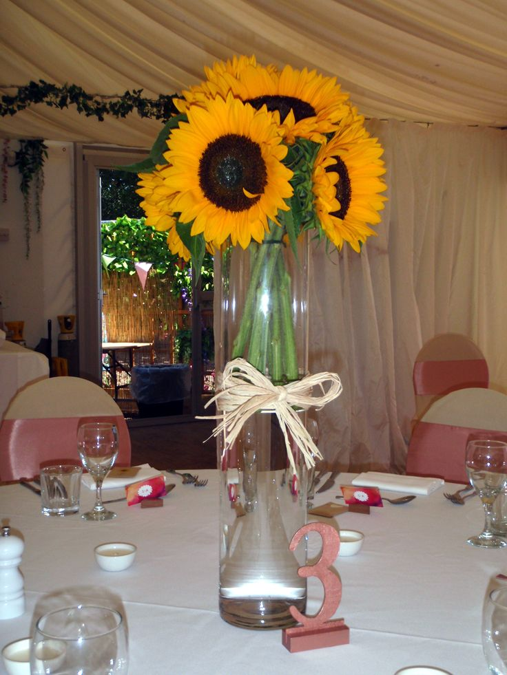 Stunning sunflower table decoration, with raffia bow