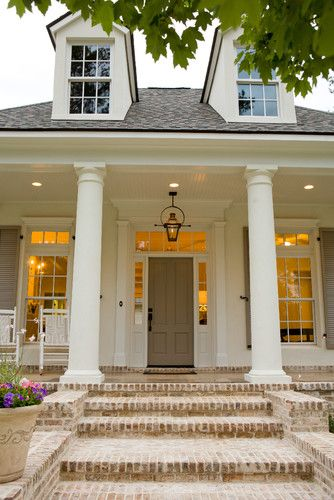 Traditional Front Porch exterior with gables and columns, great neutral paint colors and brick stairs.
