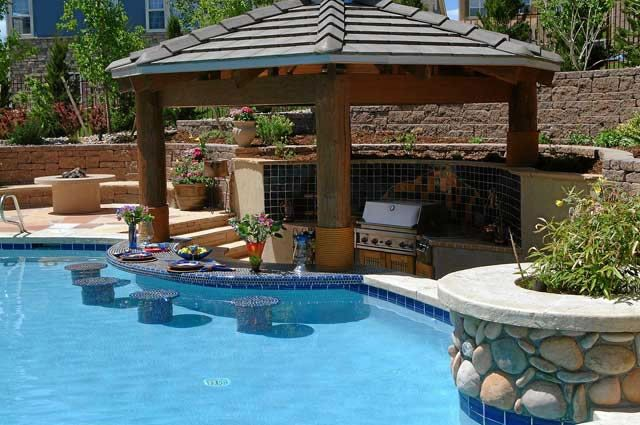Outdoor kitchens with swim up bars pool with swim up bar for Swimming pool patio designs