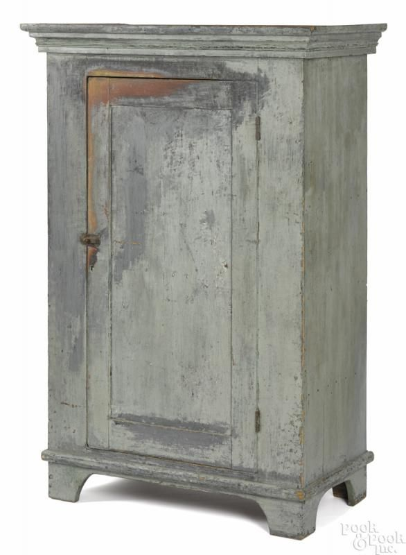Painted pine wall cupboard, 19th c., retaining an old light green surface, 59 1/2'' h., 35 1/2'' w.