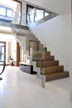 Likes this stair because it's all the same and doesn't have traditional features (nosing, separate treads and risers).    Wood should be a darker finish, likes the zig-zag-doesn't necessarily need to be metal, if it is metal would be closer to the color of the stairs.  Also would like handrail to be matching wood.  Likes that there is no structure/metal to the glass area.