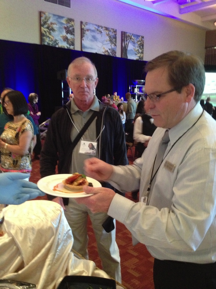 Rory Golden, Director of Food & Beverage serving guests the Ratatouille with Tonatto sauce.