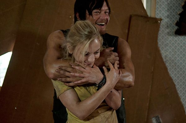 Norman Reedus (Daryl Dixon) hugs Emily Kinney (Beth Greene) on the set of AMC's 'The Walking Dead' episode 12, 'Still,' which aired on March...