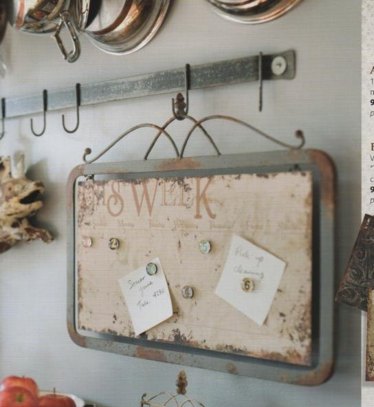 rusted/distressed baking sheet, wrought iron, hanging in entry hall-- gorgeous magnet board