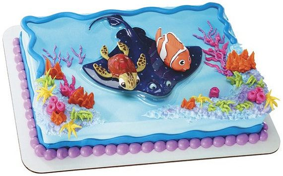 Brand New Included with this kit is, 1 Stingray base, 1 Nemo Figurine and 1 Squirt Figurine (see photo for design) Photo is of 1/4 sheet cake