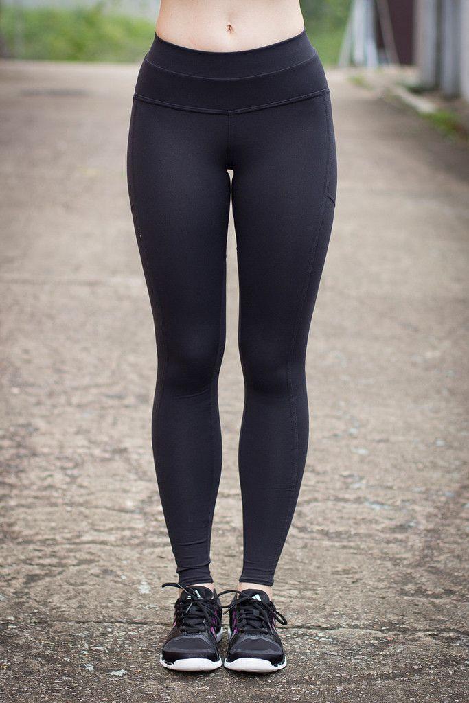 Hot girl in bright black yoga pants