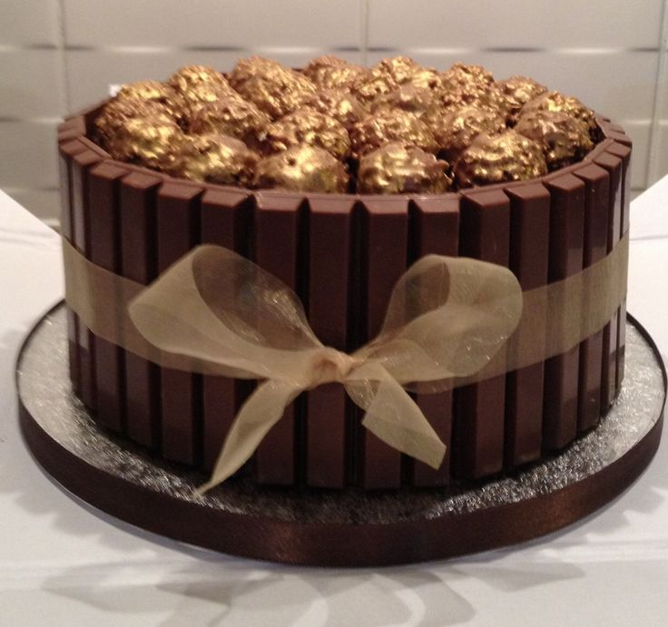 Ferrero Rocher kit Kat cake. Ferrero Roacher have been unwrapped and sprayed gold.
