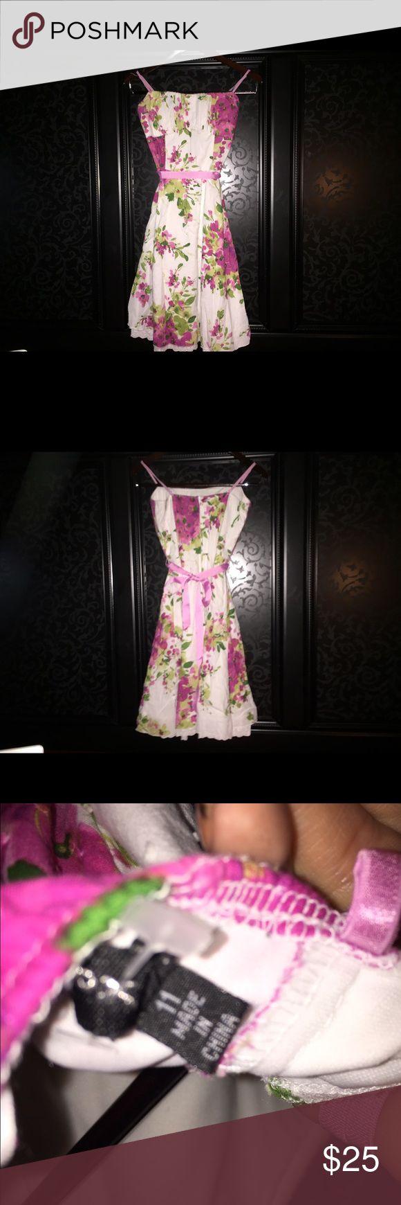 Size 11 women's floral spaghetti strap dress Floral midi dress. Size 11. Adjustable spaghetti straps, zips up the back. Pink ribbon waist sincher. Dresses Midi