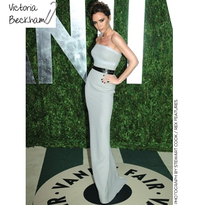 VICTORIA BECKHAM Vanity Fair Oscar Party in VB strapless dove grey gown with a belted waist