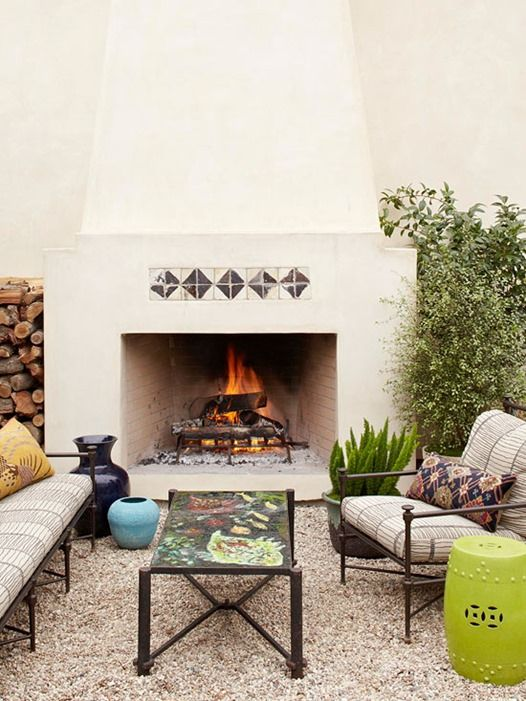 Outdoor Room Series: Patios + Balconies A Warming Space.  Mankind has gathered together around the fire for centuries, and in modern times we use fireplaces and fire pits to warm our surroundings and also to create ambiance. Invest in a permanent structure with a chimney or a simpler chiminea or fire pit.