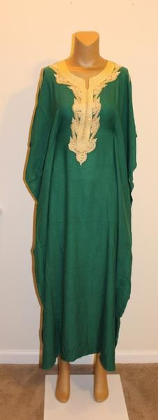 This green Moroccan kaftan/dress is trimmed in gold and has pearl accents. The dress is one size and can be worn as a kaftan or it can be fitted by using the t