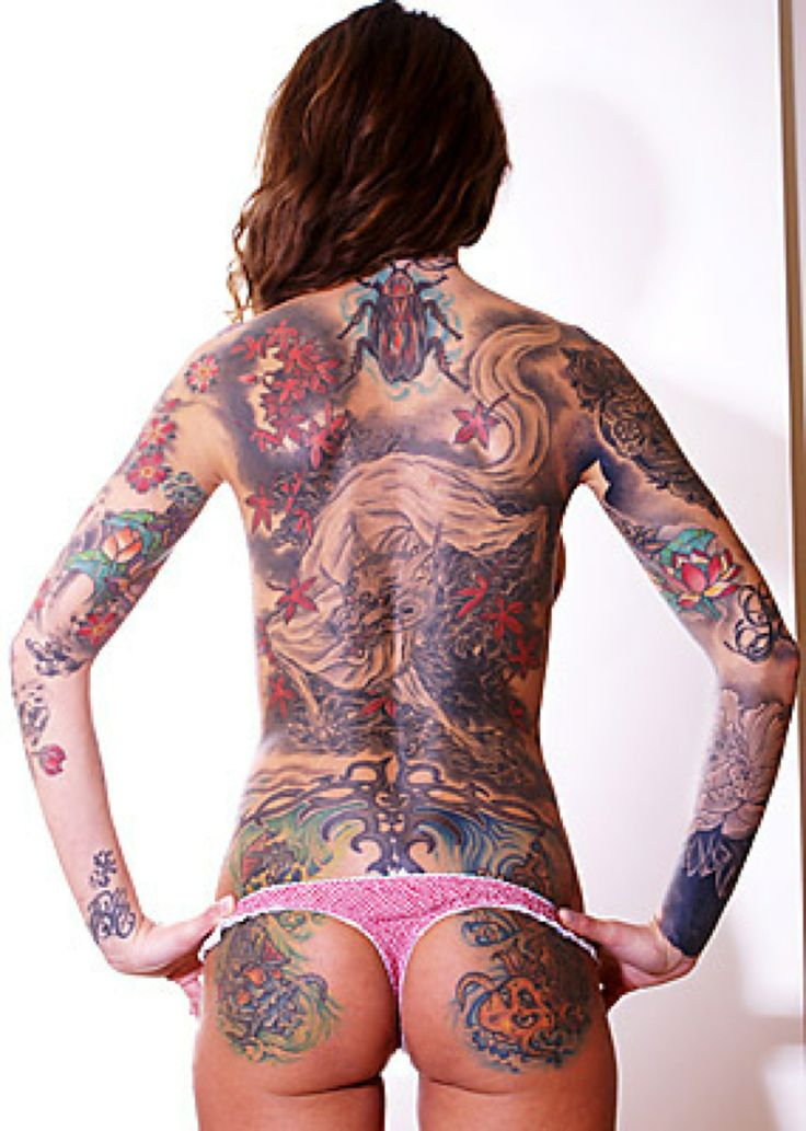hard to see the actual tattoos but she has a fair amount tattoos black gray with color. Black Bedroom Furniture Sets. Home Design Ideas
