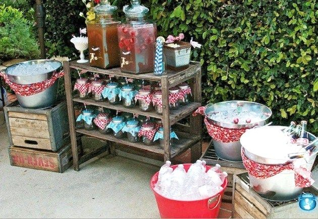 Drink decanters/dispensers on a vintage drink cart with the cutely decorated mason jar glasses for each guest below