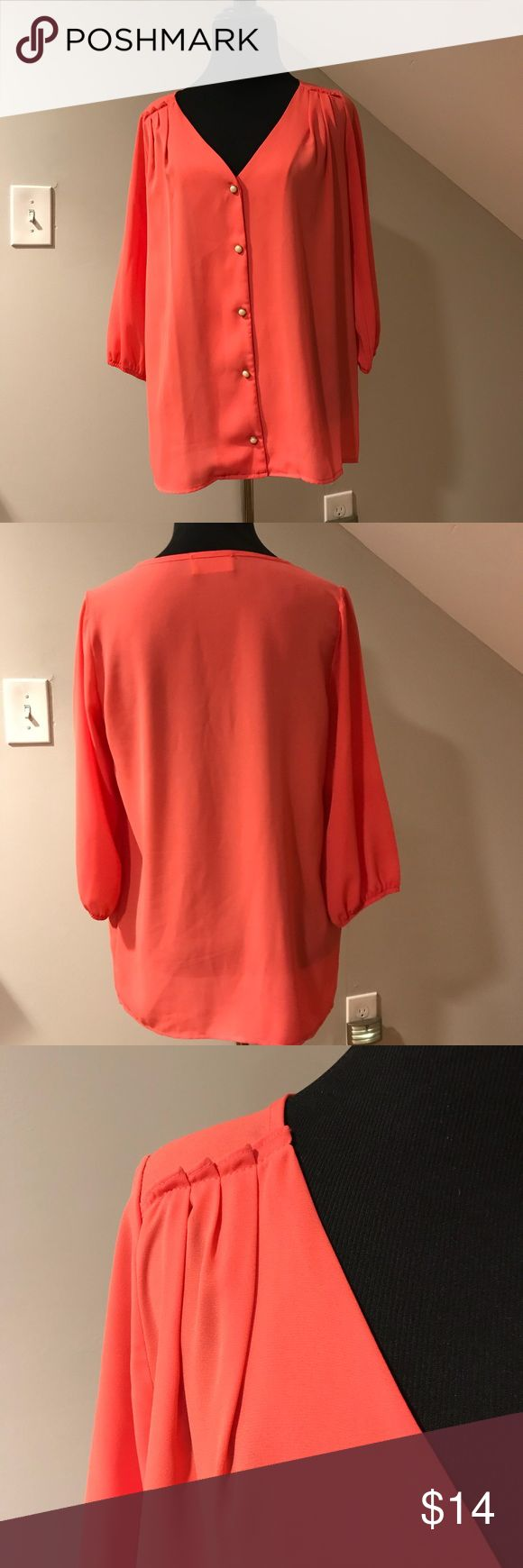 Coral blouse by Everly for ModCloth Gorgeous v-neck coral blouse from Everly bought at ModCloth! Beautiful detail at shoulders with lovely pearl buttons. Sleeves are 3/4 length. Everly Tops Blouses