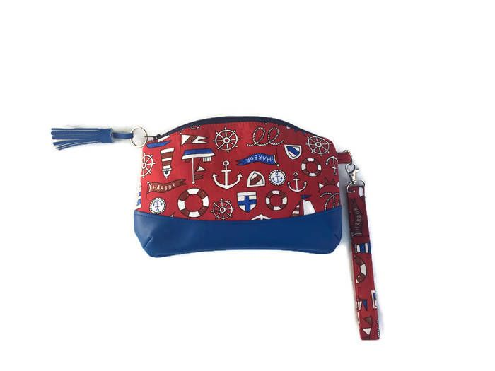 A personal favourite from my Etsy shop https://www.etsy.com/uk/listing/530343524/red-nautical-clutch-travel-purse