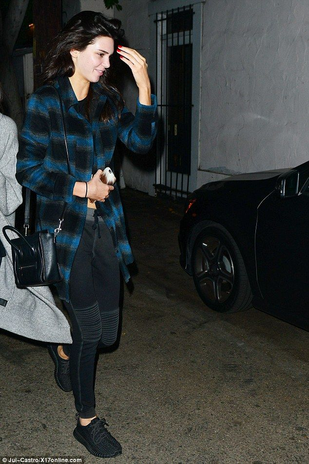 Bright spot: The Keeping Up With The Kardashians star wore a pair of brother-in-law Kanye West's Adidas Yeezy sneakers