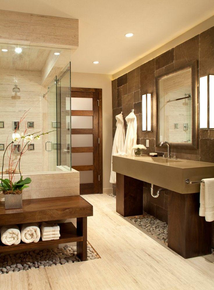 Tile wall. Bathroom door. Rocks on floor. Sink. Would put shelving below for towels etc.