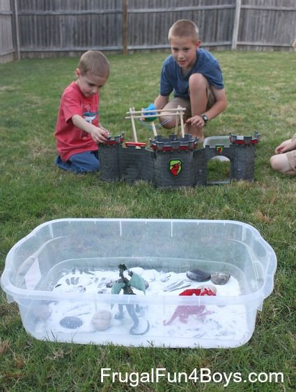 Castle Catapult Attack!  Capatult + toy dragons + baking soda and vinegar = awesome imaginative play set-up!
