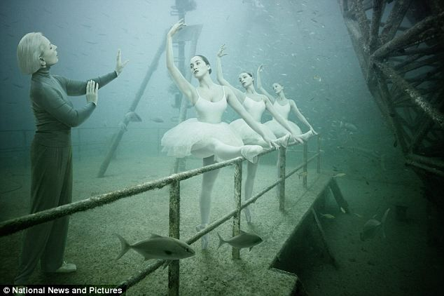 Eerie: Ballerinas practice their dance moves in this eerie image created by photographer Andreas Franke and displayed underwater