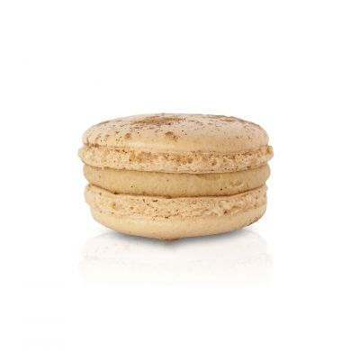 Coconut Chai Macaron. A white chocolate and coconut ganache, warmed with chai spices