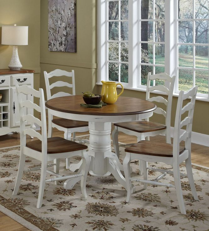 this farmhouse white 5 piece dining room set includes a round pedestal base table and