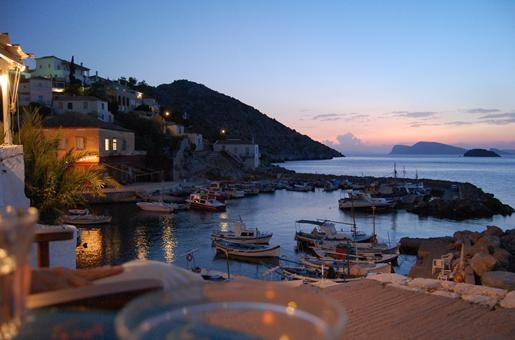 Hydra, Greece's dinner views from Kodylenia's Taverna, which marries the charm of Kaminia's port, the bustle of water vessels, and the 'beauties of a Greek isle escape.