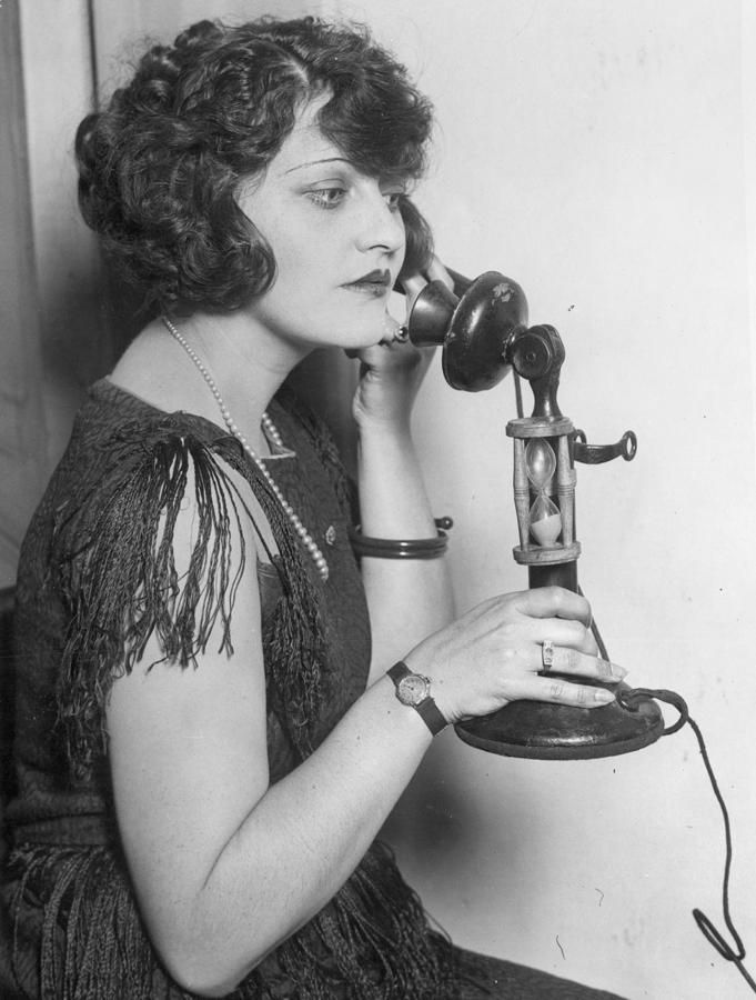 Using the candlestick telephone in the 20s.