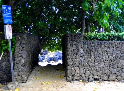 Picture of rock wall entrance to Secret Cove in Makena Maui, Hawaii.