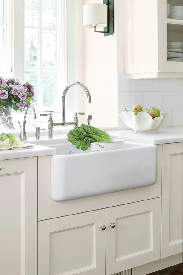 Timeless Farmhouse Sink - Farmhouse Sinks with Vintage Charm - Southernliving. Designed more than 115 years ago, this classic Shaws Original farmhouse sink is simple without being boring, and it's extra deep for washing pots and pans.    See more of this Lighten Up Kitchen Update Love it? Get it! Sink: Shaws Original Single Bowl Fireclay Apron Sink (RC3018)