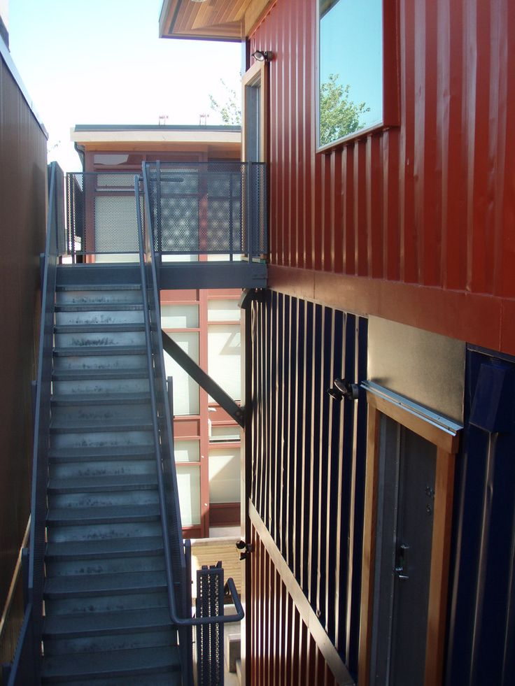 Shipping Container Homes Unveiled In Vancouver's Downtown Eastside (PHOTOS) - 12 unit low income housing costing about $85K per studio will be rented to seniors and women meeting low income qualifications.